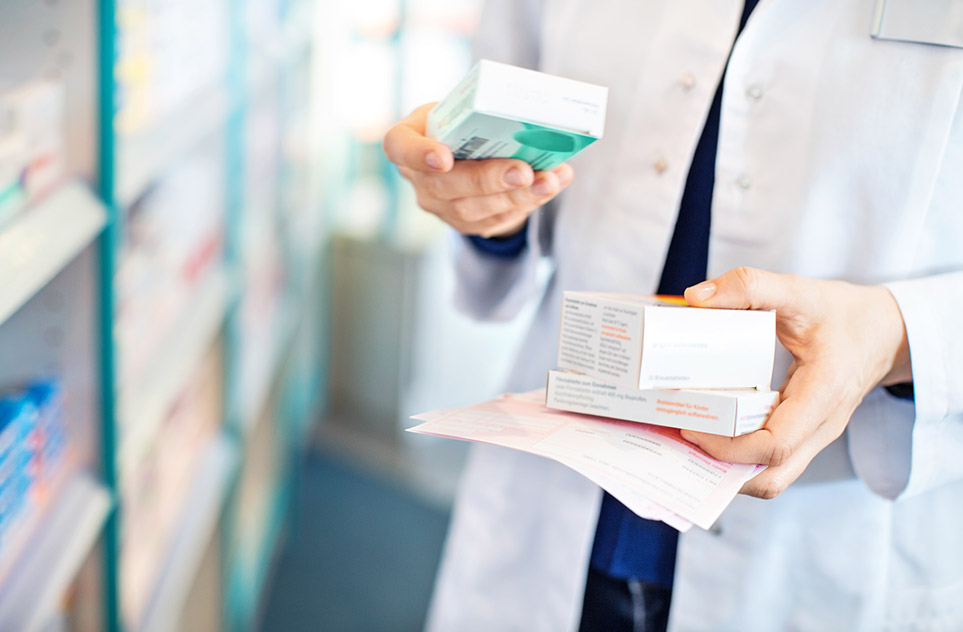 Pharmaceutical researcher holding drugs